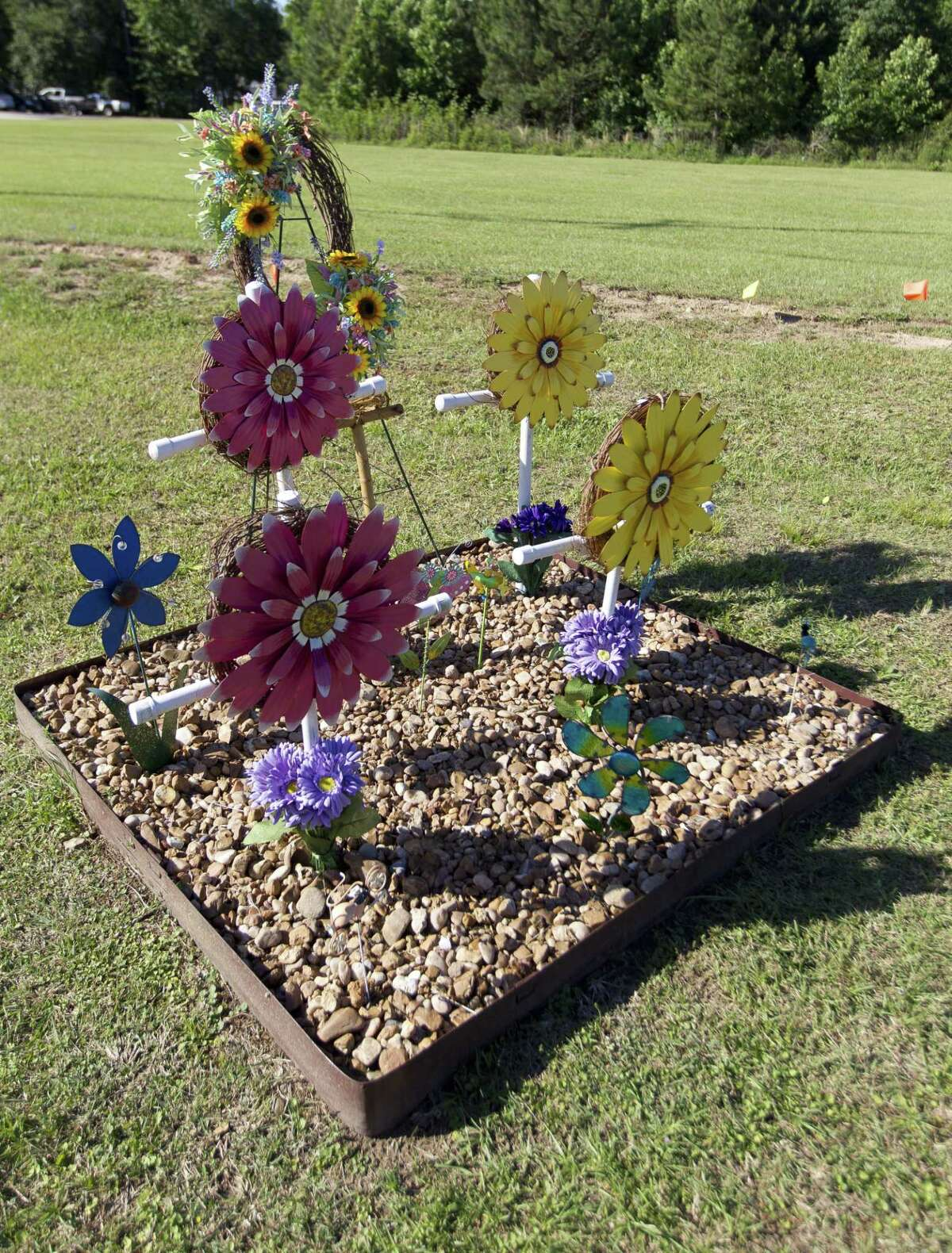 A memorial in honor of Roland Sedlmeier, his wife and his two children is seen near Marina Drive and Texas 105, Thursday, May 4, 2017, in Montgomery. The Sedlmeier family were killed after their vehicle was struck by Ronald Cooper, who was found guilty of driving high on prescription pills.