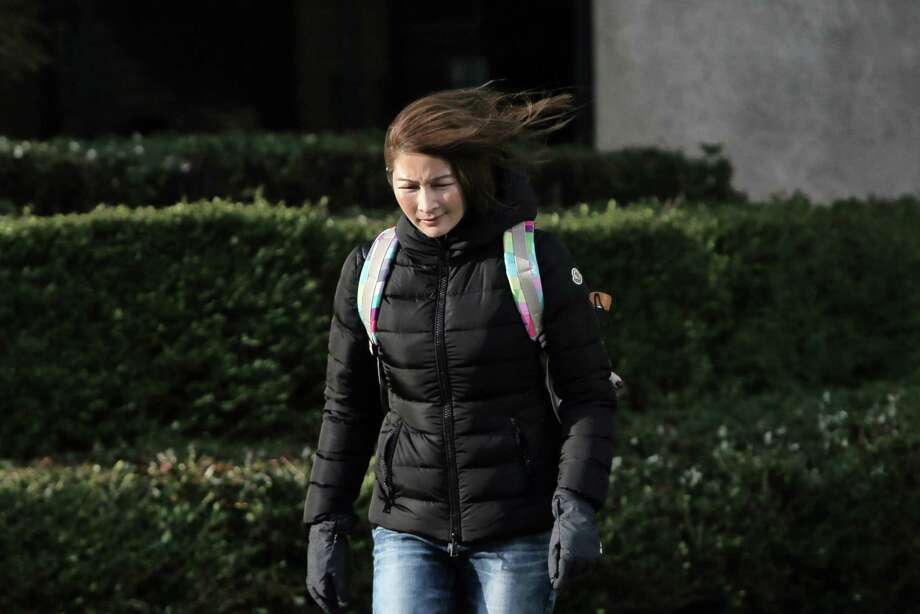 Pedestrians make their way through a windy downtown Seattle, Thursday afternoon, Dec. 20, 2018. Wind gusts were expected to be as high as 65 mph. Photo: GENNA MARTIN, GENNA MARTIN, SEATTLEPI.COM / SEATTLEPI.COM