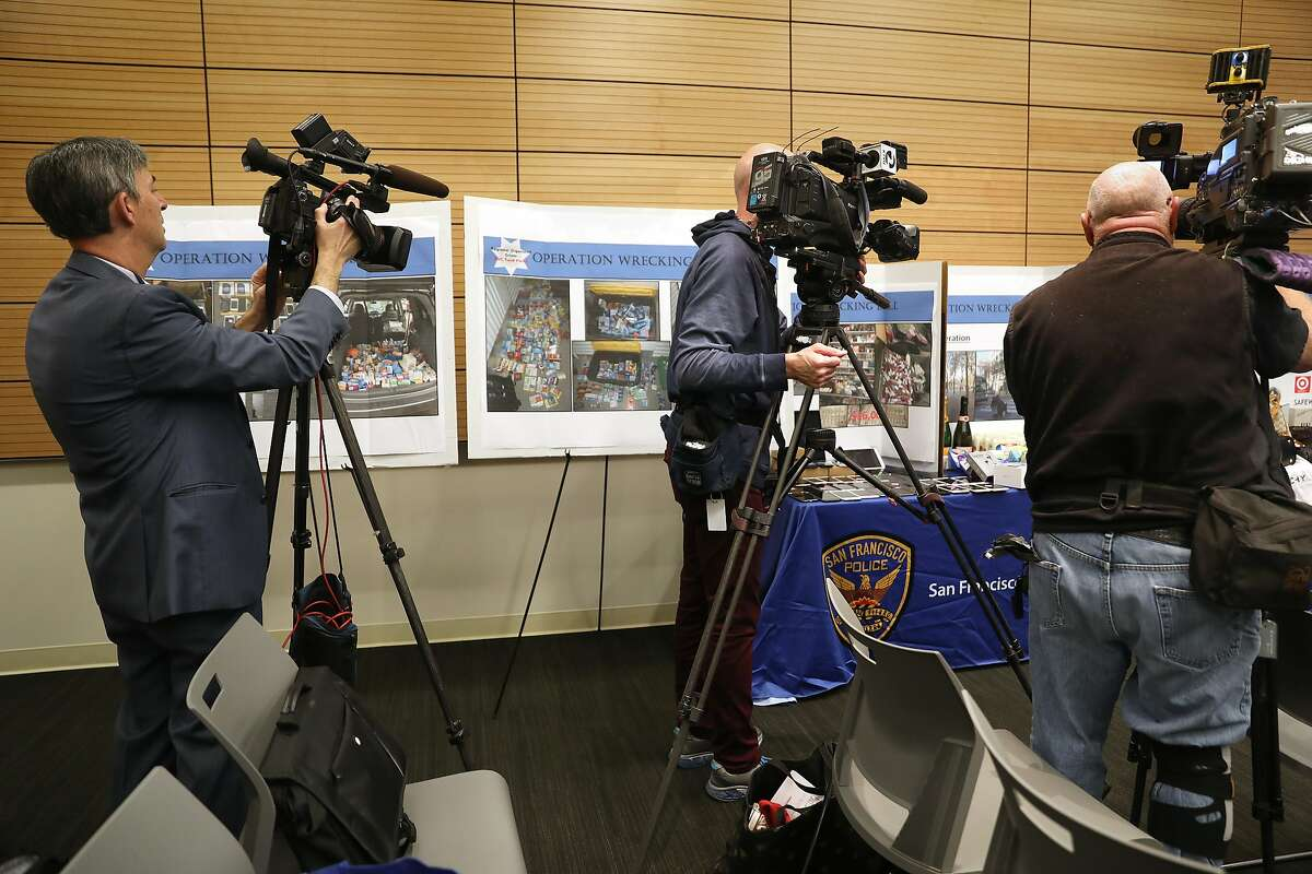 """Media stations take pictures of stolen property after law enforcement officials announce the dismantling of a major fencing operation dubbed """"operation wrecking ball"""" where investigators identified $750,000 in stolen property on Thursday, Dec. 20, 2018, in San Francisco, Calif."""