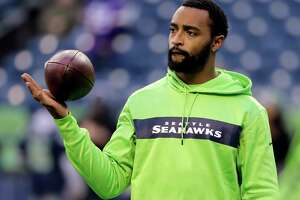 FILE - In this Monday, Dec. 10, 2018, file photo, Seattle Seahawks' Doug Baldwin looks on during warm-up before an NFL football game against the Minnesota Vikings in Seattle. Baldwin has been fortunate to have spent eight years in the NFL without having a season defined injuries affecting his play, until this year.