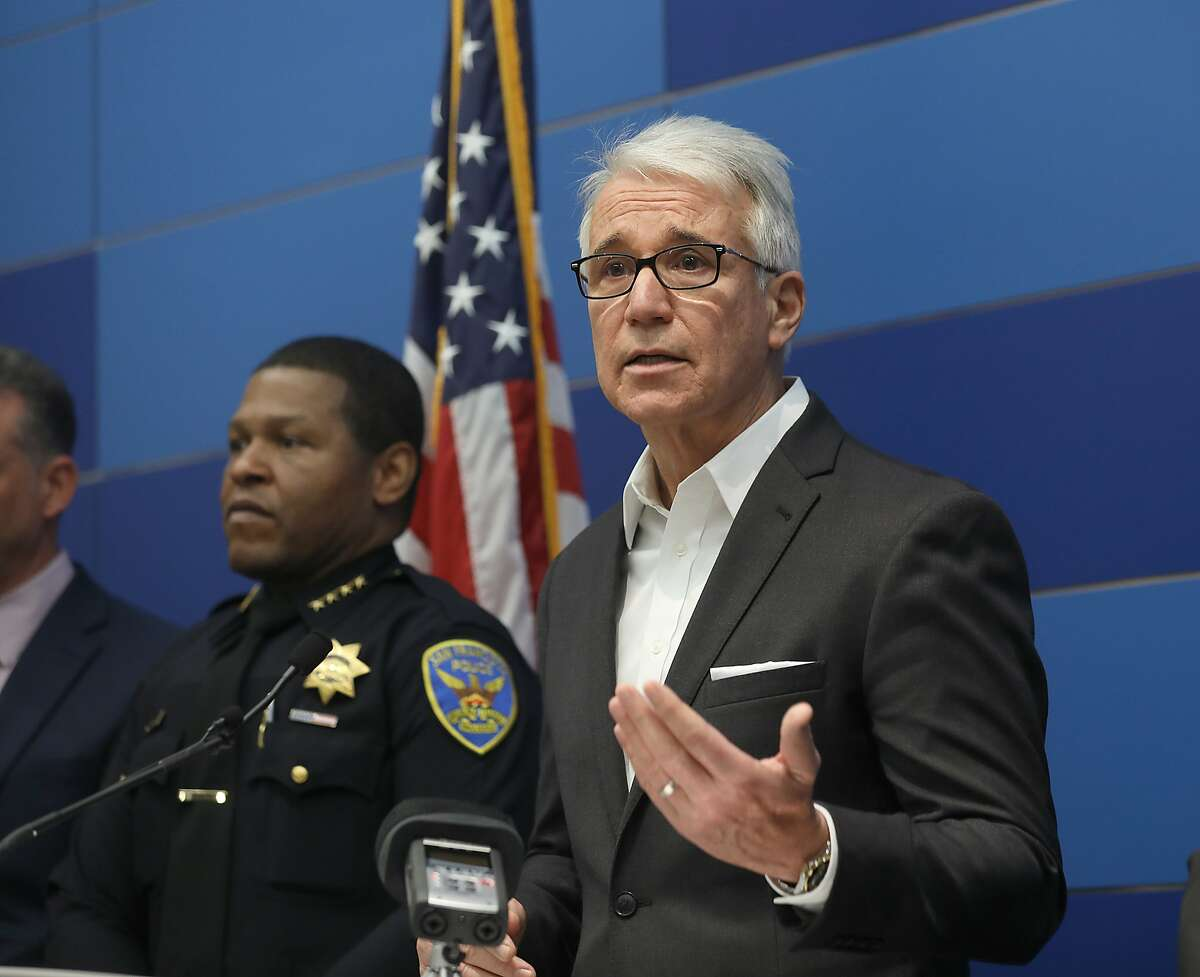"""Law enforcement officials including district attorney George Gascon (right) and SF police chief Will Scott (left) announce the dismantling of a major fencing operation dubbed """"operation wrecking ball"""" in which 40 fugitives were identified and 12 people were arrestedon Thursday, Dec. 20, 2018, in San Francisco, Calif."""