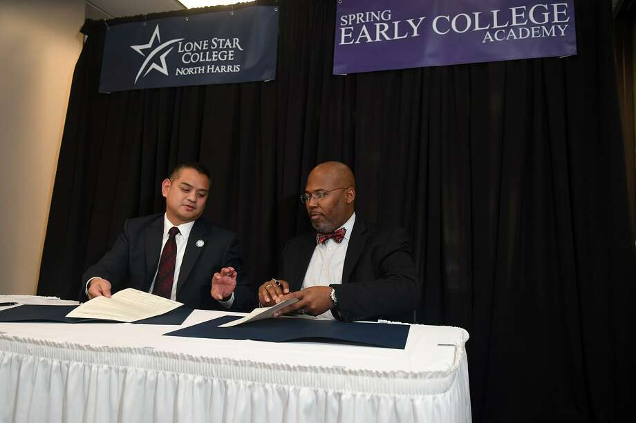Dr. Gerald Fernandez-Napoles, left, President of Lone Star College-North Harris, and Dr.Rodney E. Watson, Spring ISD Superintendent of Schools, preform the formal signing ceremony during the Spring Early College Academy Signing Ceremony in the school's Academic Building on Dec. 18, 2018. Photo: Jerry Baker, Houston Chronicle / Contributor / Houston Chronicle