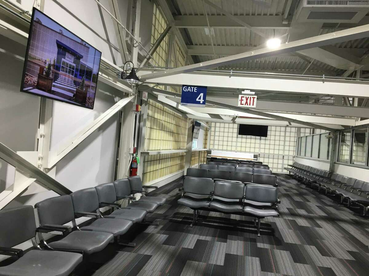 The refubished jetbridge and upgraded upstairs gate waiting area at Tweed New Haven Regional Airport await passengers when the service begins on Saturday, Dec. 22, 2018