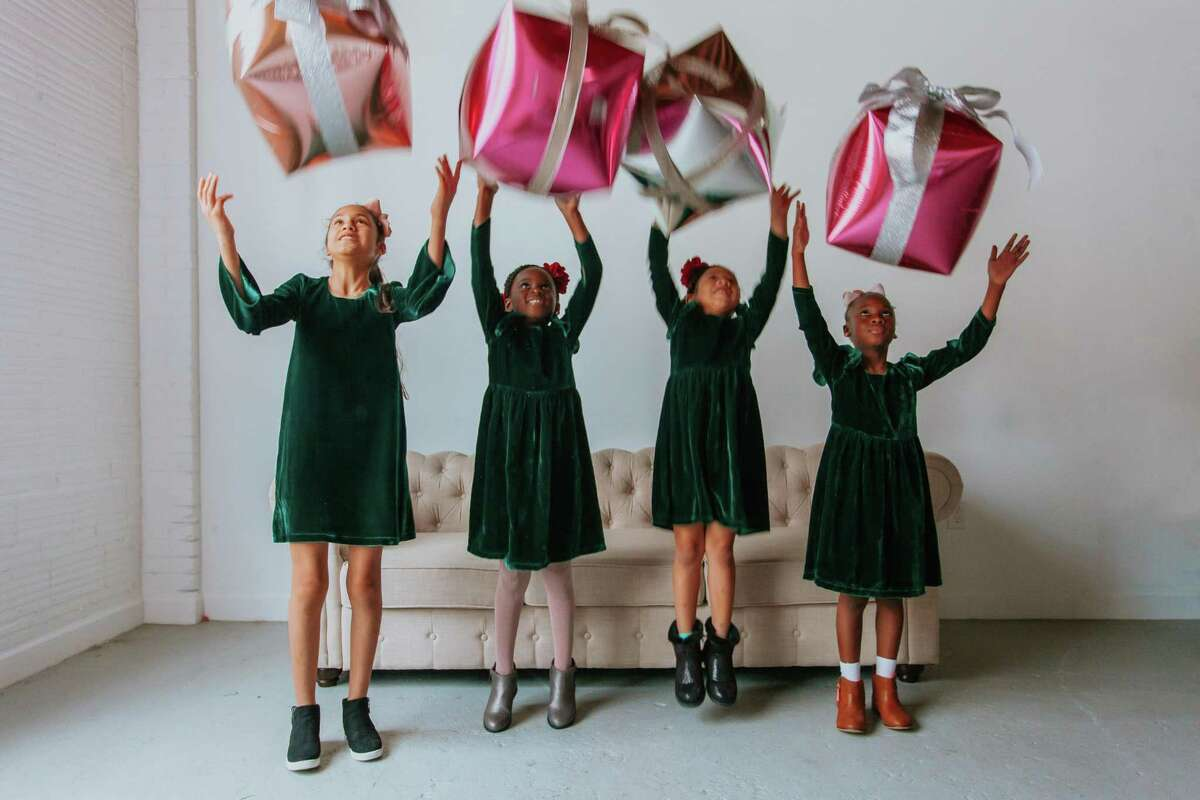 """Aaliyah Leon, 10, Brielle Brown, 6, Mari Grays, 5, and Lily Howe, 7, wear the """"Joy"""" dress by Cuteheads designer Esther Freedman."""