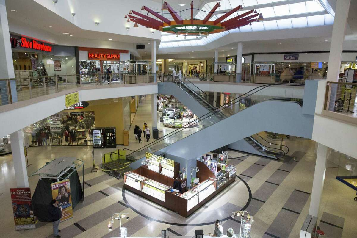 Guests shop at PlazAmericas on Thursday, Dec. 20, 2018, in Houston. Baker Katz, a Houston-based full-service commercial real estate firm, has purchased PlazAmericas Mall, an 850,000-square-foot enclosed center.