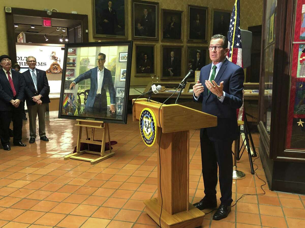 Outgoing Gov. Dannel P. Malloy discusses his eight years in office during an unveiling ceremony for his official state portrait at the Museum of Connecticut History in Hartford, Conn., Thursday, Dec. 20, 2018. Past and present advisers, friends, family members and supporters gathered at the Museum of Connecticut History Thursday for the unveiling ceremony. The Democrat leaves office on Jan. 9. (AP Photo/Susan Haigh)