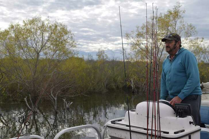 """Veteran Choke Canyon Guide Marvin """"Catfish Marv"""" Elledge cruises the edge of recently flooded brush at the reservoir in search of hot spots to hook up with wintertime catfish."""