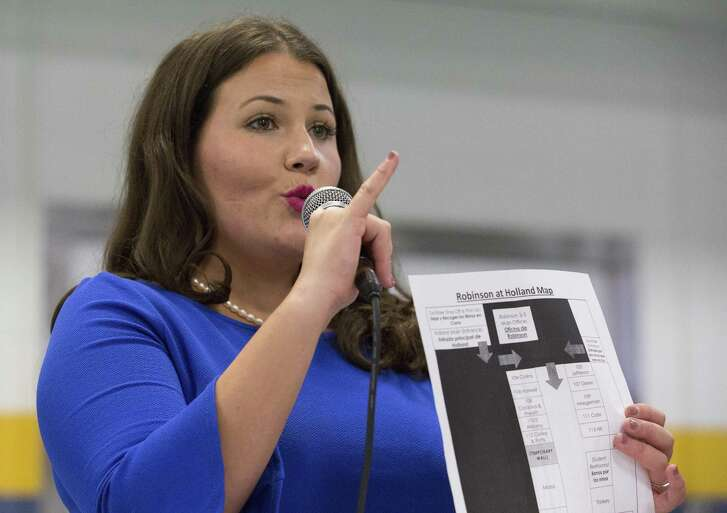 Robinson Elementary School Principal Paige Fernandez-Hohos holds a Robinson ES school at Holland Middle School map during a Houston ISD community meeting at the cafeteria of Holland MS Wednesday, Sept. 13, 2017, in Houston. Hundreds of students and family participated the meeting regarding to relocating Robinson ES to Pleasantville Elementary and Holland MS. ( Yi-Chin Lee / Houston Chronicle )