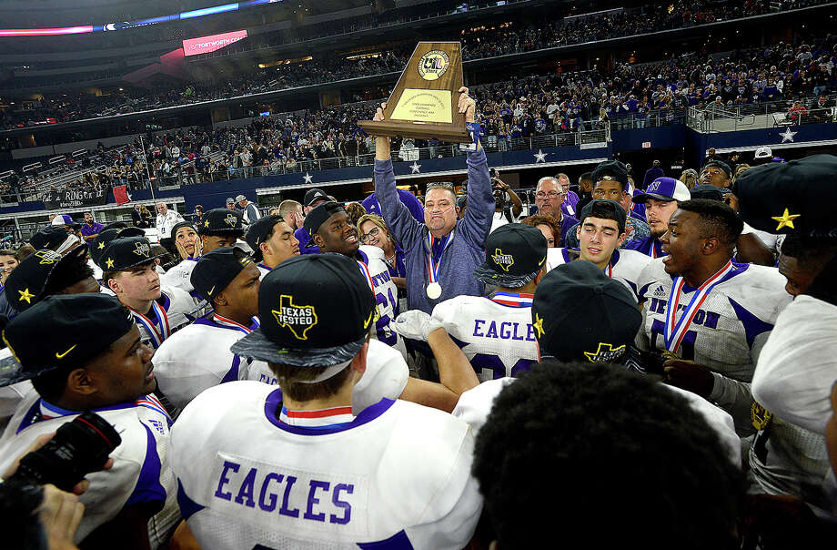 Newton gathers round head coach W. T. Johnston as he congratulates therm on their repeat state title victory after defeating Candian 21 - 16 during their state final Class 3A Div. II game at AT&T Stadium.