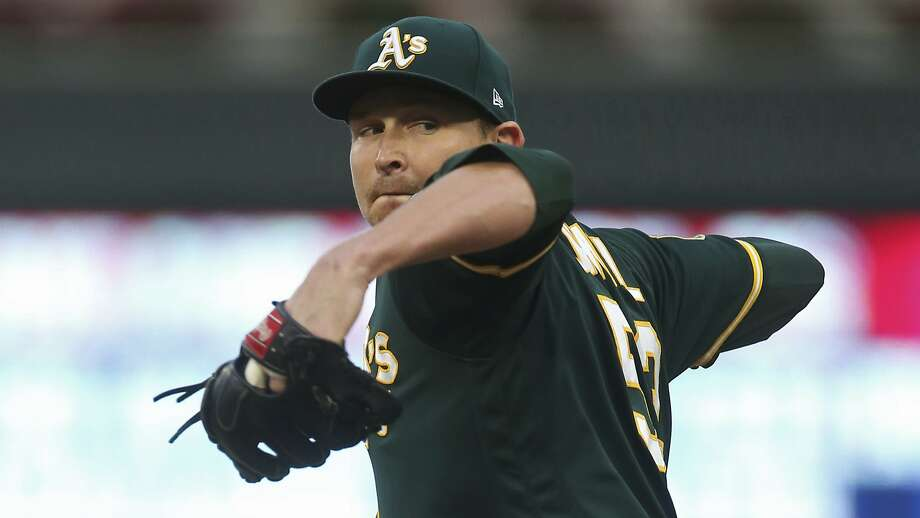 FILE - In this Aug. 23, 2018, file photo, Oakland Athletics pitcher Trevor Cahill throws against the Minnesota Twins in the first inning of a baseball game in Minneapolis. The Los Angeles Angels have added to their pitching staff, agreeing to a $9 million, one-year deal with Cahill. (AP Photo/Jim Mone, File) Photo: Jim Mone, Associated Press