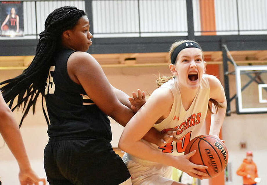 Edwardsville's Katelynne Roberts, right, goes up strong to the basket in the second quarter against Granite City. Photo: Matt Kamp/Intelligencer