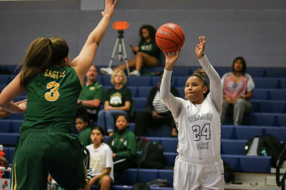 College Park's Talynne Buckmon (24) shoots as Cy-Falls' Dejia Cormier (3) defends during the varsity girls basketball game on Tuesday, Nov. 14, 2017, at College Park High School. (Michael Minasi / Houston Chronicle) Photo: Michael Minasi, Staff Photographer / Houston Chronicle / © 2017 Houston Chronicle