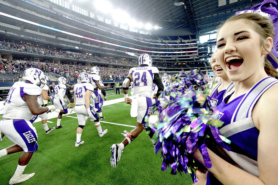 Newton bursts onto the field to face Candian's during their state final Class 3A Div. II game at AT&T Stadium. Photo taken Thursday, December 20, 2018 Kim Brent/The Enterprise Photo: Kim Brent/The Enterprise
