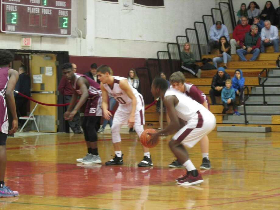 Torrington's boys basketball team won a nail-biter against Naugatuck Thursday night. Photo: Peter Wallace / For Hearst Connecticut Media