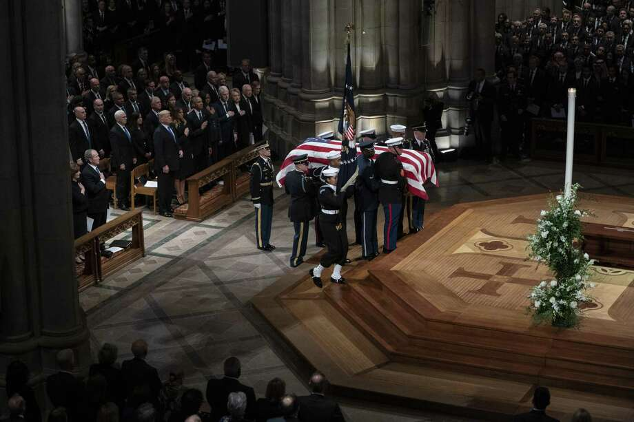 The flag-draped casket of former President George H.W. Bush is carried by a military honor guard past former President George W. Bush and wife Laura Bush, President Donald Trump, first lady Melania Trump, former President Barack Obama, Michelle Obama, former President Bill Clinton, former Secretary of State Hillary Clinton, former President Jimmy Carter, and Rosalynn Carter during a State Funeral at the National Cathedral Dec. 5, 2018, in Washington. Photo: Carolyn Kaster /Associated Press / Copyright 2018 The Associated Press. All rights reserved.