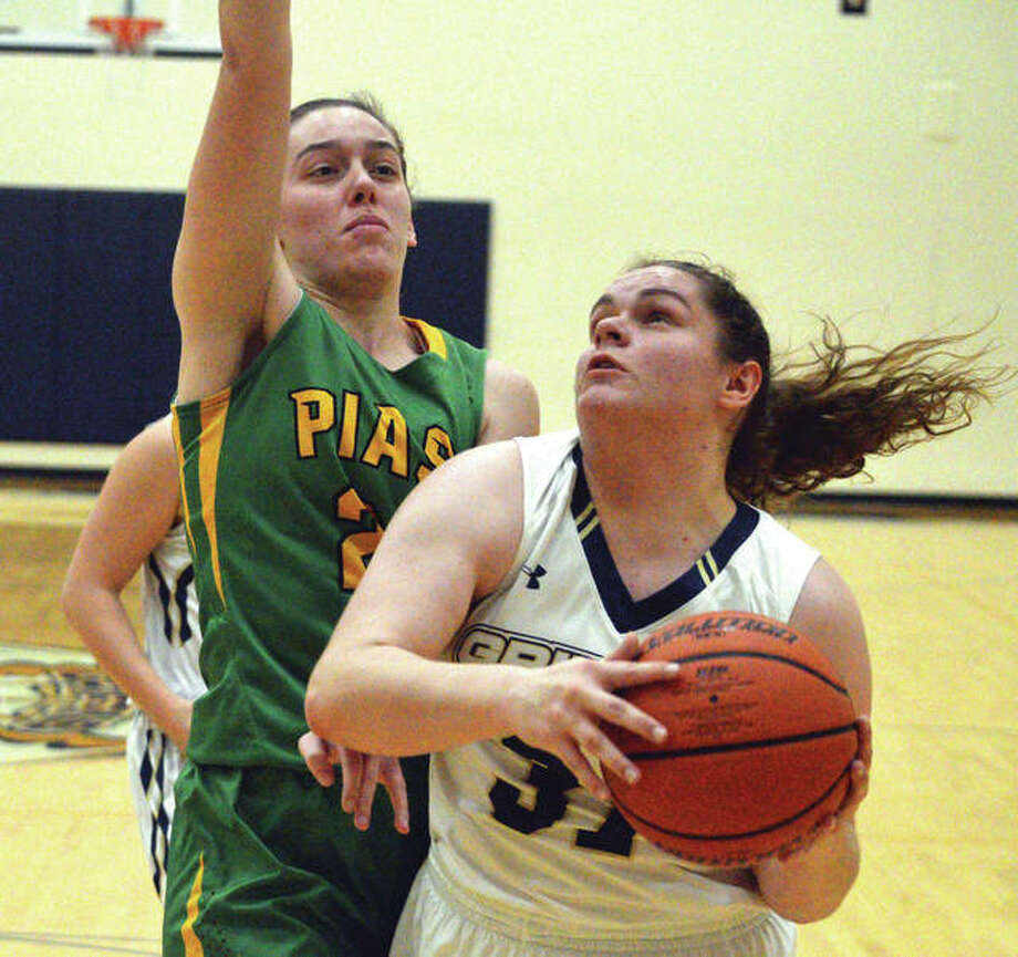 Father McGivney's Caitlyn Pendall (right) looks to put up a shot while Southwestern's Bailey Weible defends during Thursday's game against Piasa Southwestern in Glen Carbon. Photo: Scott Marion / Hearst Illinois