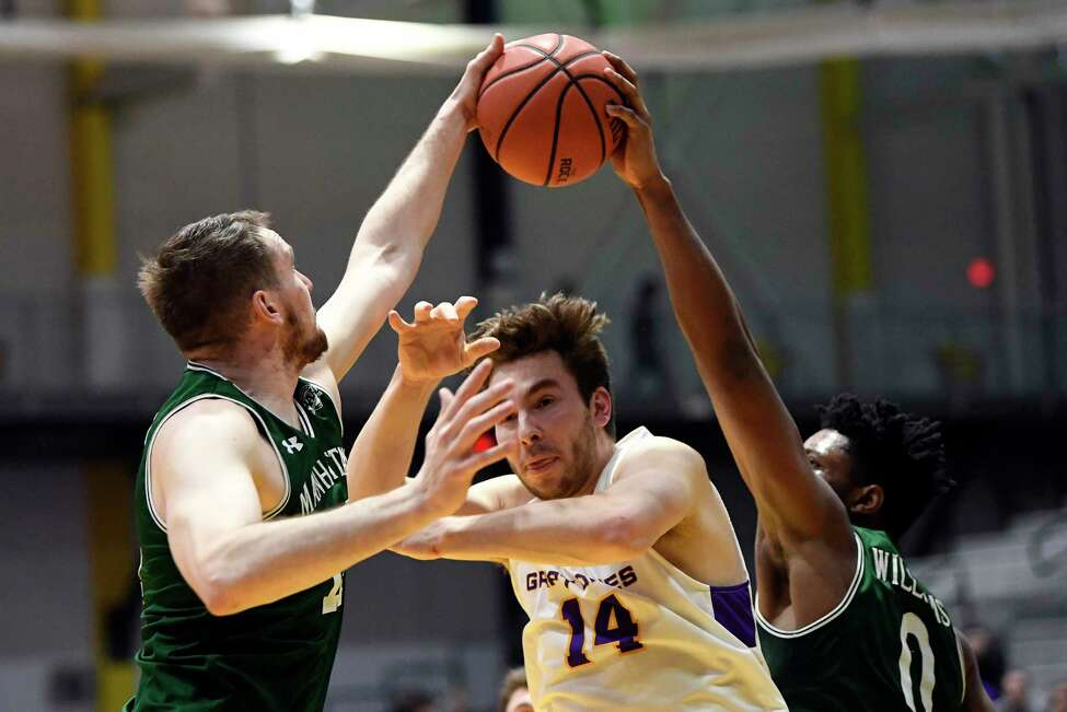 Manhattan's Tyler Reynolds ,left, and teammate Warren Williams ,right, strip the ball from University at Albany forward Adam Lulka during the first half of an NCAA college basketball game Thursday, Dec 20, 2018, in Albany, N.Y. (Hans Pennink / Special to the Times Union)