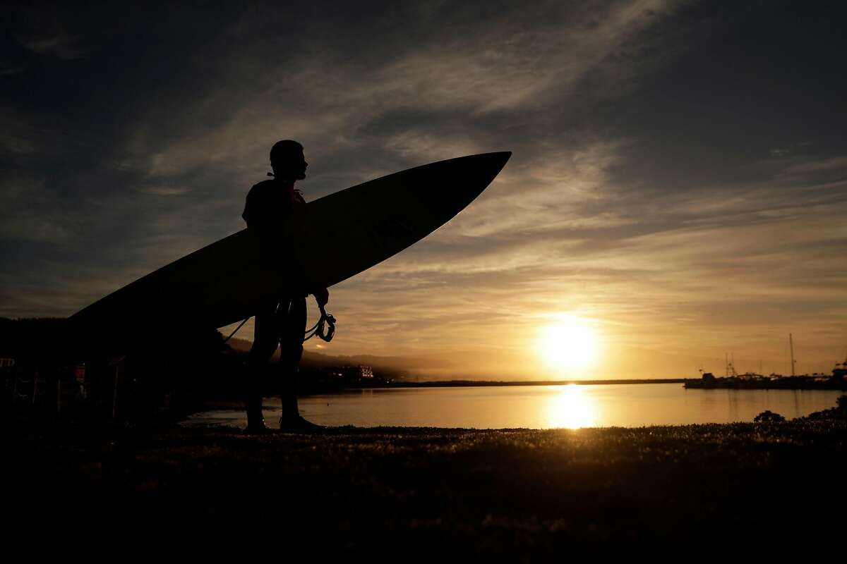 Teen surfer Luca Padua prepares to catch some waves at Mavericks near Half Moon Bay, Calif., on Thursday, December 20, 2018.