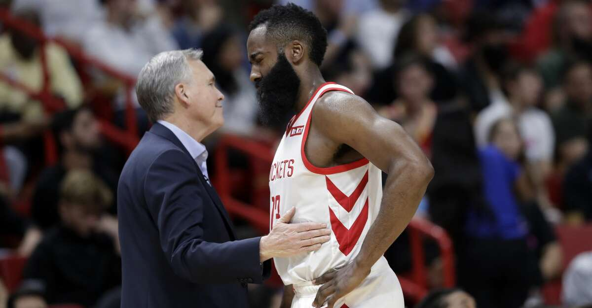 Houston Rockets head coach Mike D'Antoni, pats guard James Harden (13) on the chest during the second half of an NBA basketball game against the Miami Heat, Thursday, Dec. 20, 2018, in Miami. The Heat won 101-99. (AP Photo/Lynne Sladky)