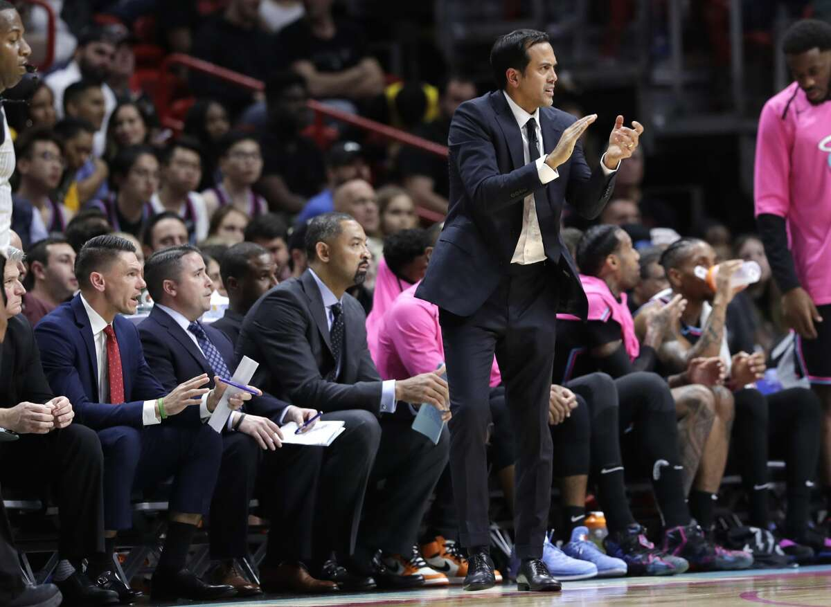 Miami Heat head coach Erik Spoelstra watches during the second half of an NBA basketball game against the Houston Rockets, Thursday, Dec. 20, 2018, in Miami. The Heat won 101-99. (AP Photo/Lynne Sladky)
