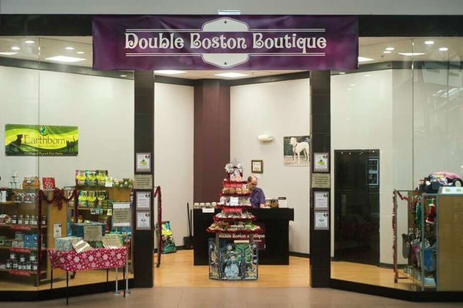 Dog food, accessories, homemade treats and more are available inside a new store in the Midland Mall, called Double Boston Boutique. (Katy Kildee/kkildee@mdn.net)
