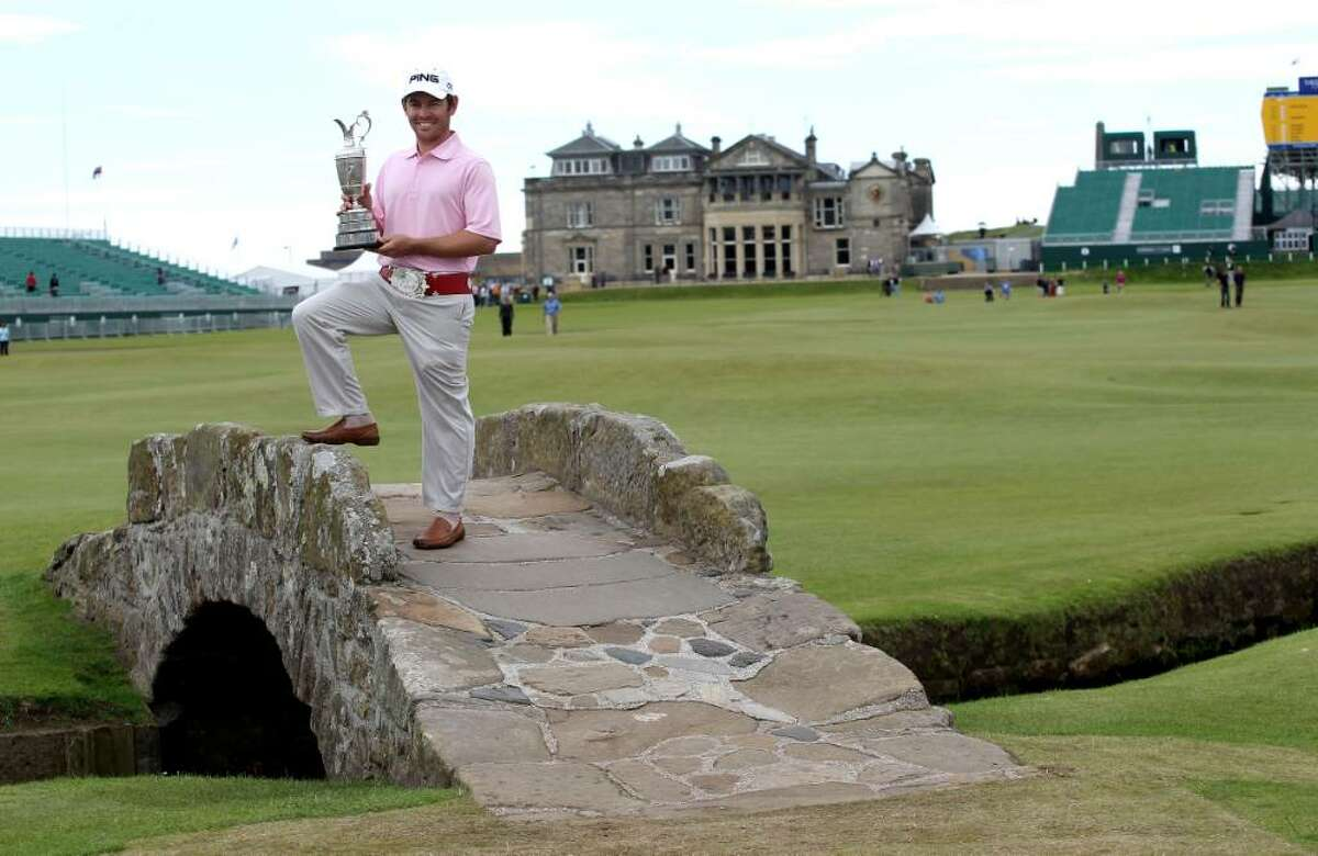 South Africa's Louis Oosthuizen holds the Claret Jug on the Swilken Bridge as he celebrates winning The Open Championship 2010 during a photo call at the Old Course St Andres, Scotland, Monday, July 19, 2010. (AP Photo/Peter Morrison)