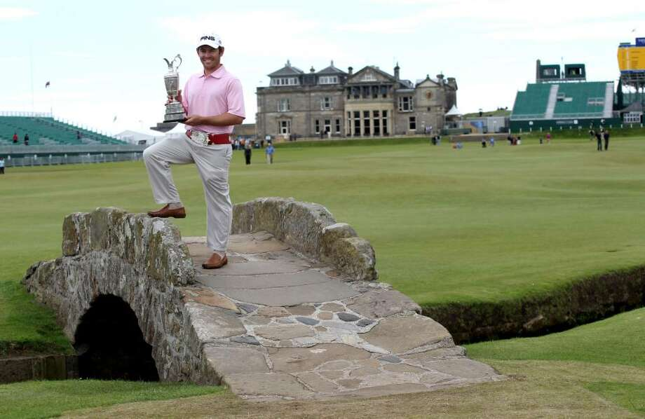 South Africa's Louis Oosthuizen holds the Claret Jug on the Swilken Bridge as he celebrates winning The Open Championship 2010 during a photo call at the Old Course St Andres, Scotland, Monday, July 19, 2010. (AP Photo/Peter Morrison) Photo: Peter Morrison, ASSOCIATED PRESS / AP