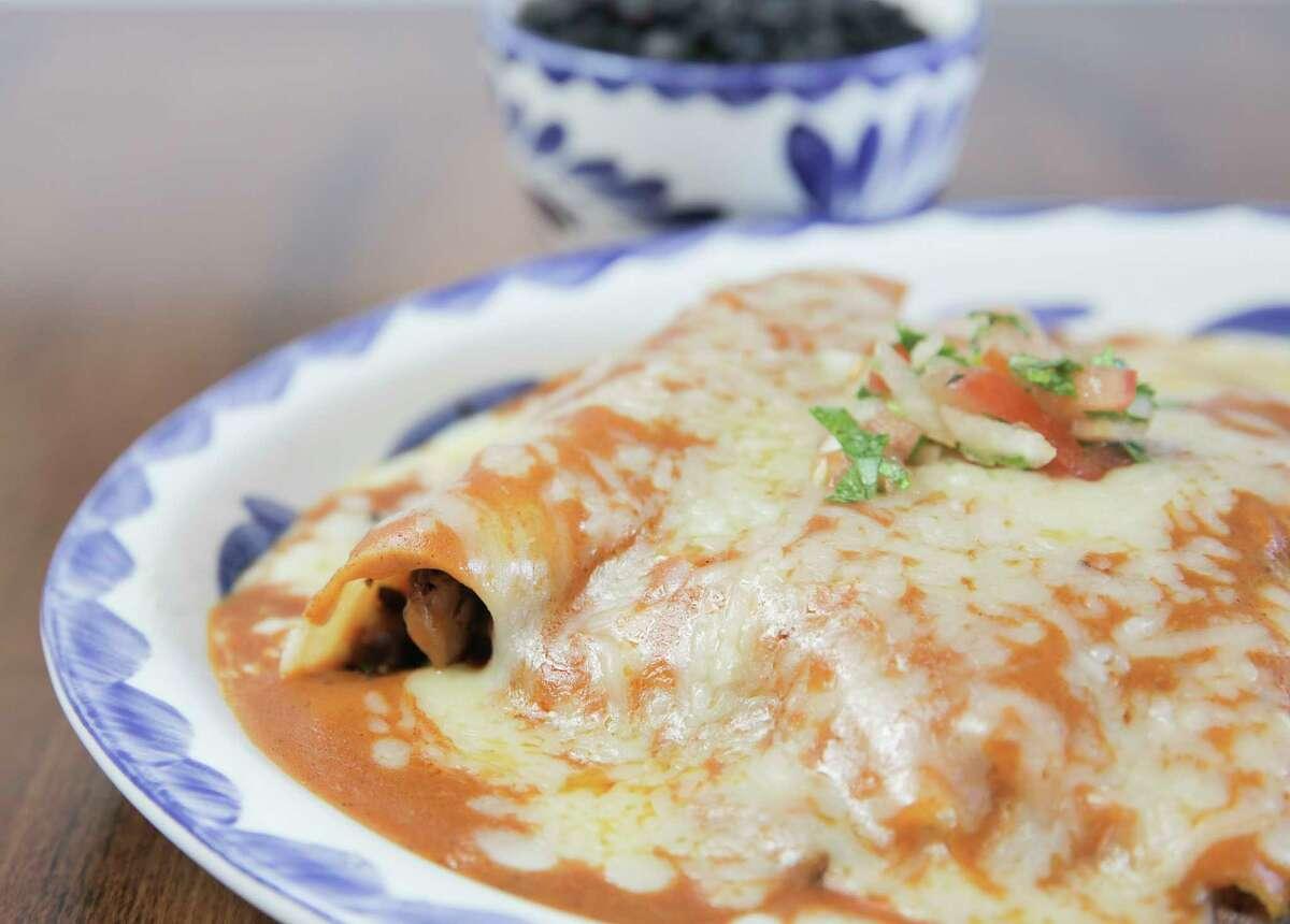 Smoked brisket enchiladas with black beans and rice at Killen's TMX.