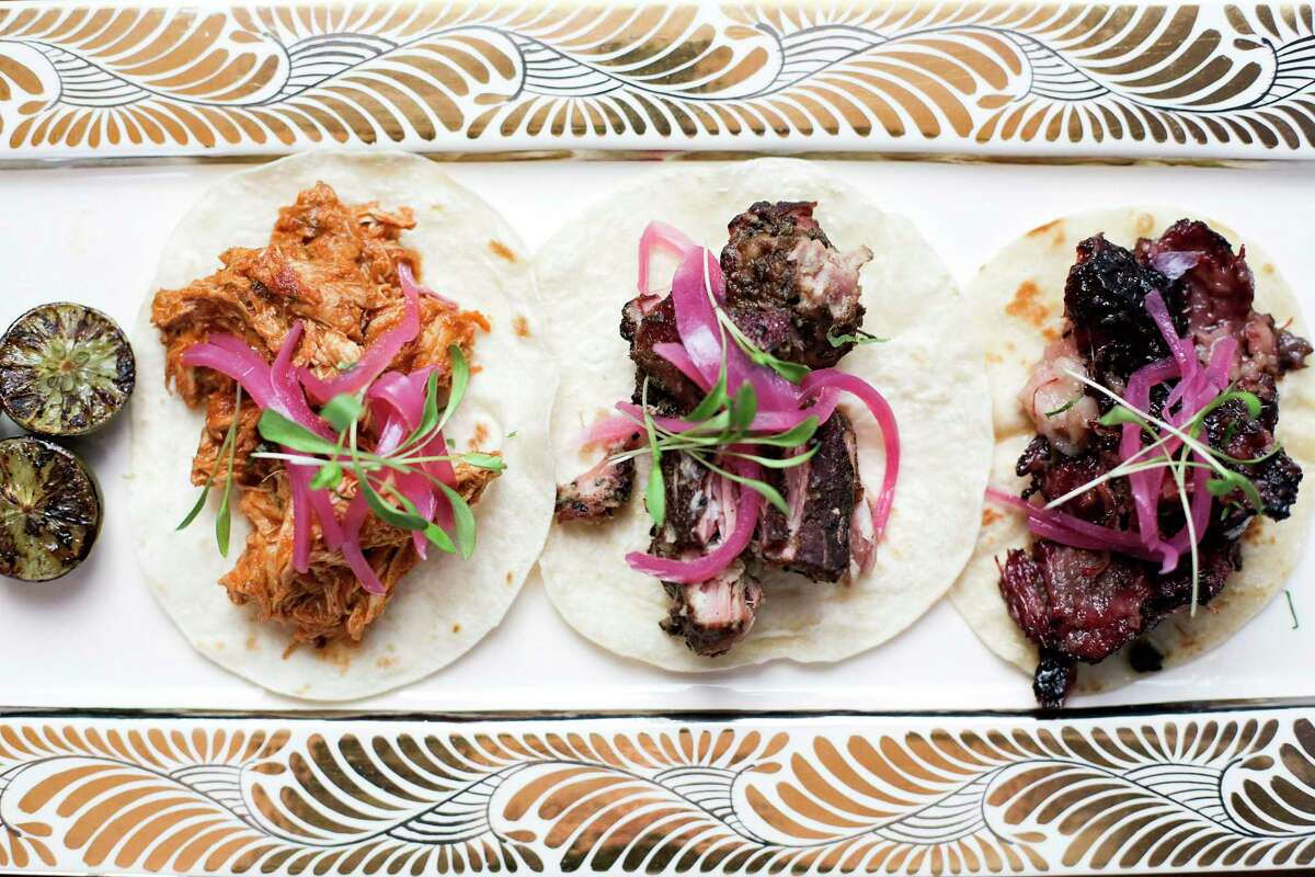 Street tacos including smoked tinga, carnitas and beef cheek at Killen's TMX in Pearland.