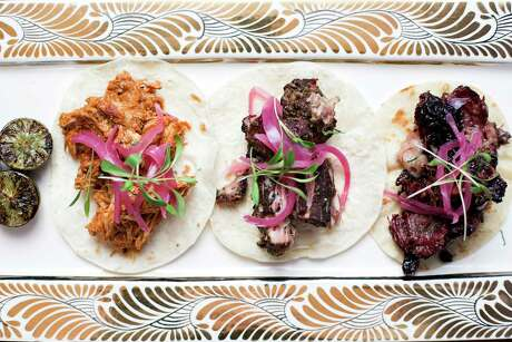 Street tacos including Tinga, carnitas and smoked beef cheek at Killen's TMX, Ronnie Killen's new Tex-Mex concept, is opening soon.