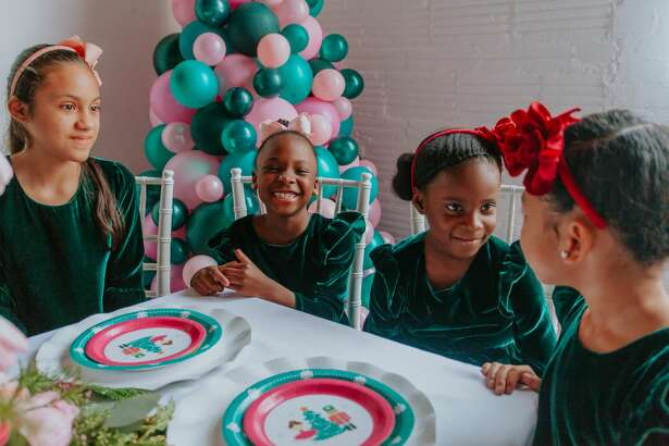 """Aaliyah Leon, 10, Lily Howe, 7, Brielle Brown, 6, Mari Grays, 5, and wear the """"Joy"""" dress by Cuteheads designer Esther Freedman. The girls are part of Hype Freedom School."""