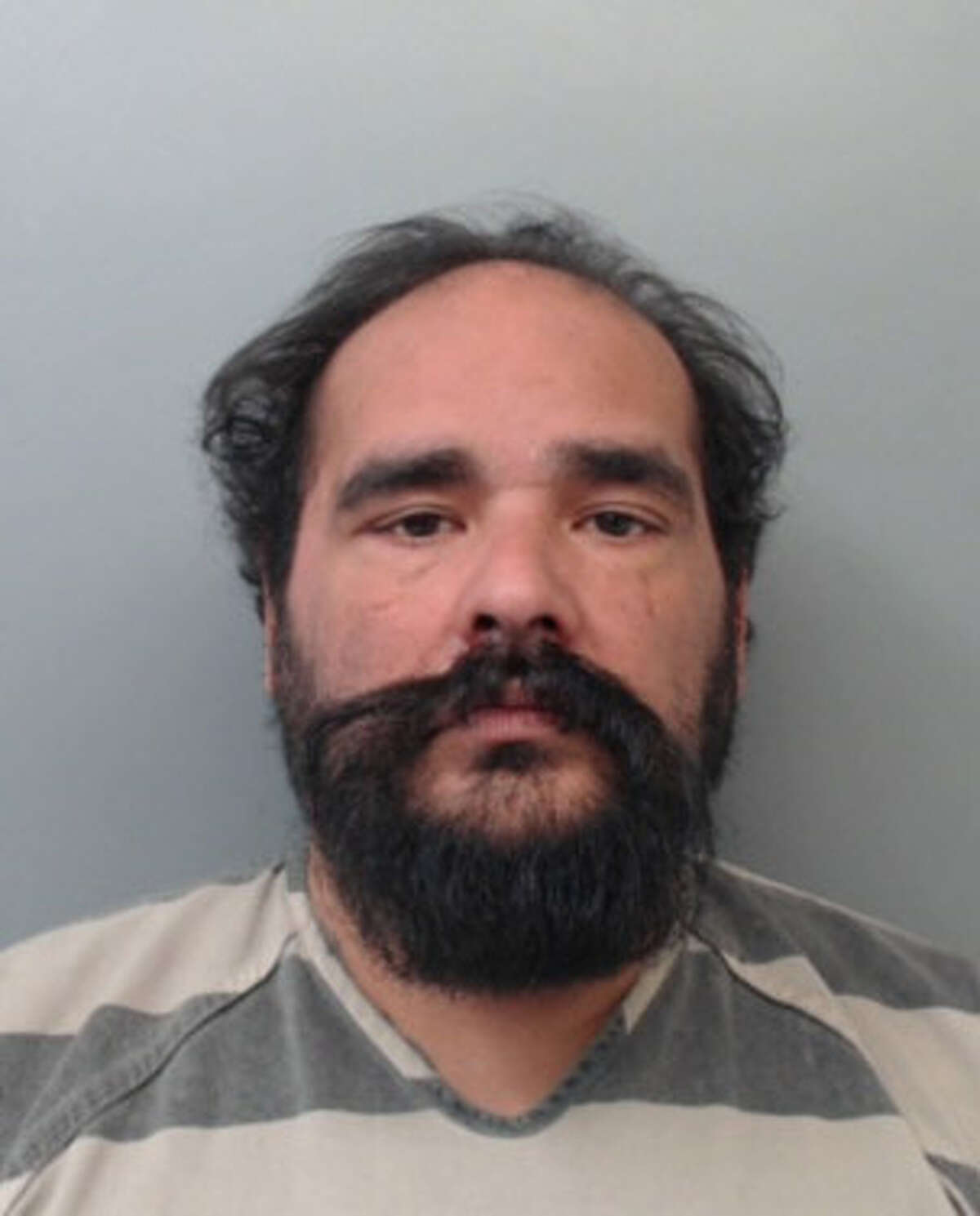Troy Alardin, 51, was charged with arson and possession of marijuana.