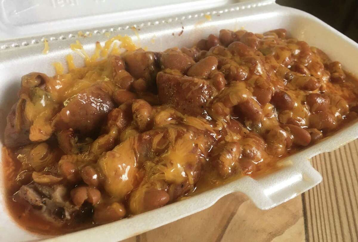 The Heavy D ($7.95) is a special dish that has about 3/4 pound of chopped brisket and sausage, topped with cheddar cheese, beans and barbecue sauce.
