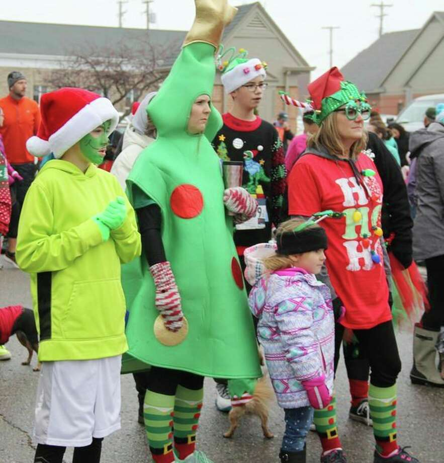 Getting into the festive spirit, runners donned all sorts of different Christmas gear at the Whobilation Recreation Jubilation 5K and Max & Cindy Lou Who's Fun Run on Nov. 24. (Tribune File Photo)