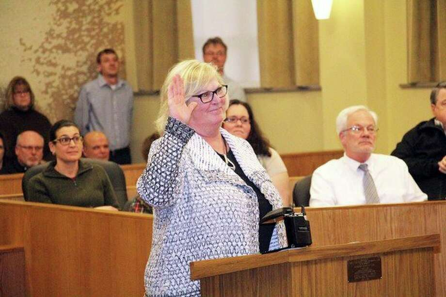 Newly-elected Huron County Commissioner Mary Ellen Babcock is sworn in. (Seth Stapleton/Huron Daily Tribune)
