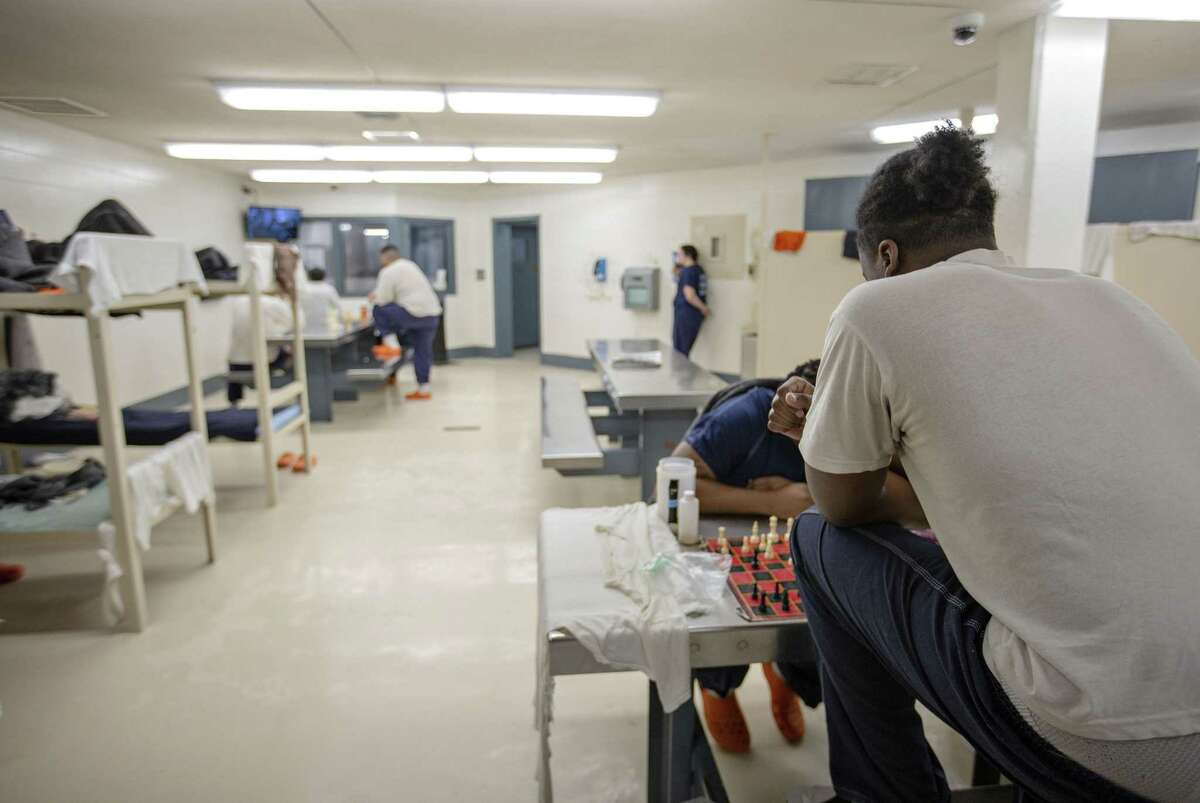 Inmates watch television, read books, play games and do their own thing in D2 which is currently one shy of max capacity with 23 inmates at the Hays County Jail on December 20, 2018 in San Marcos, Texas.