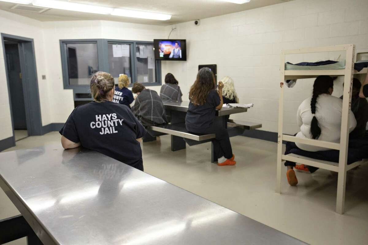 Some female inmates watch the television in C2 dormitory at the Hays County Jail on December 20, 2018 in San Marcos, Texas.