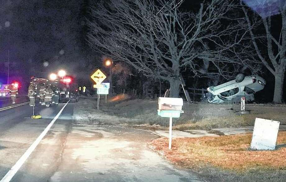 An accident early Friday left a car upside down in a yard along U.S. 54. The crash, which resulted in a charge of driving under the influence, also caused a power outage near the scene.