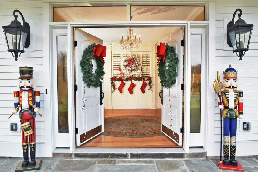 Holiday decorated front doors and foyer of Kathy Schneider's home Thursday Nov. 30, 2017 in Troy, NY. (John Carl D'Annibale / Times Union)