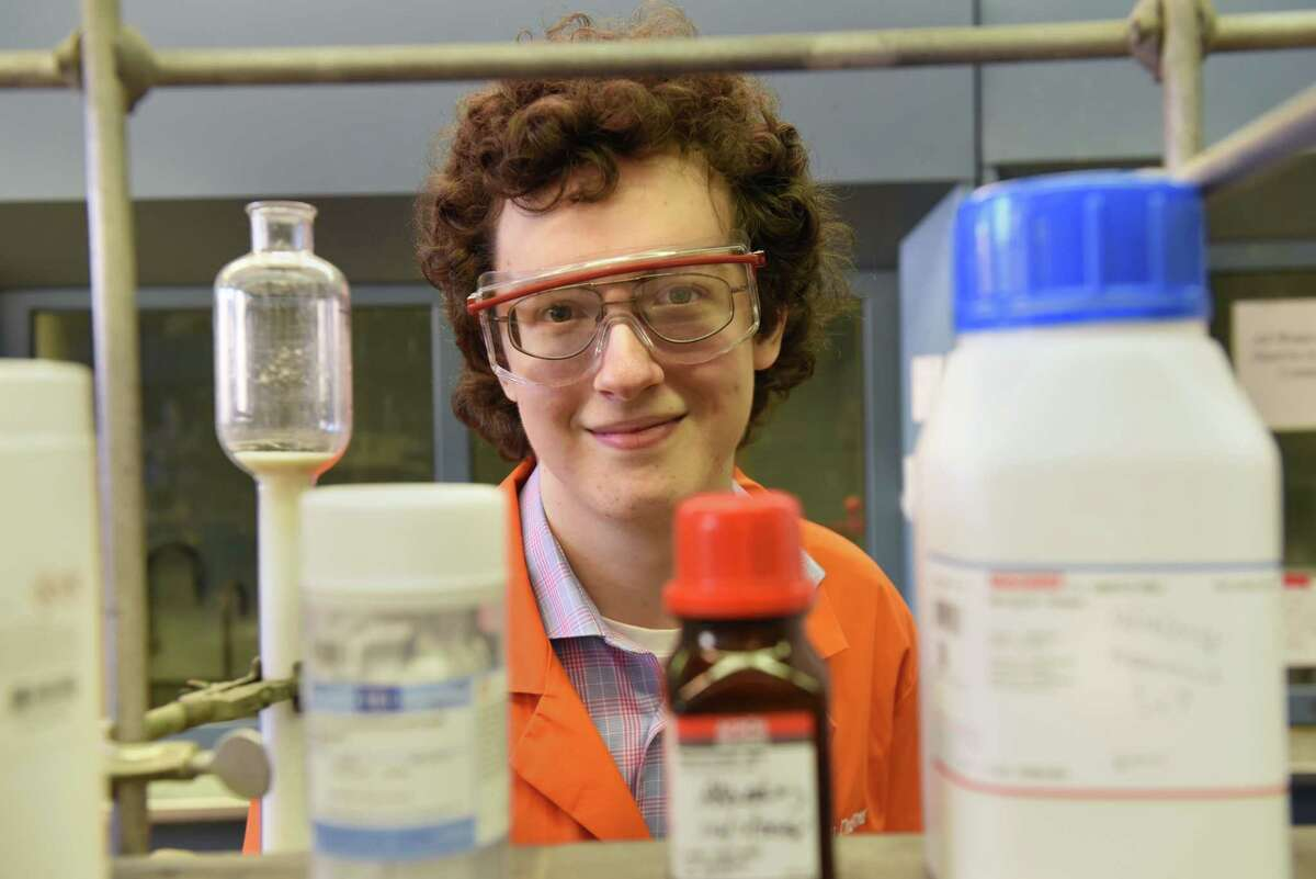 Rensselaer Polytechnic Institute 15-year-old chemistry student Julian Dupont stands at a lab station in the Cogswell Laboratory on Tuesday, Dec. 18, 2018 in Troy, N.Y. Dupont hopes to be a doctor someday. (Lori Van Buren/Times Union)