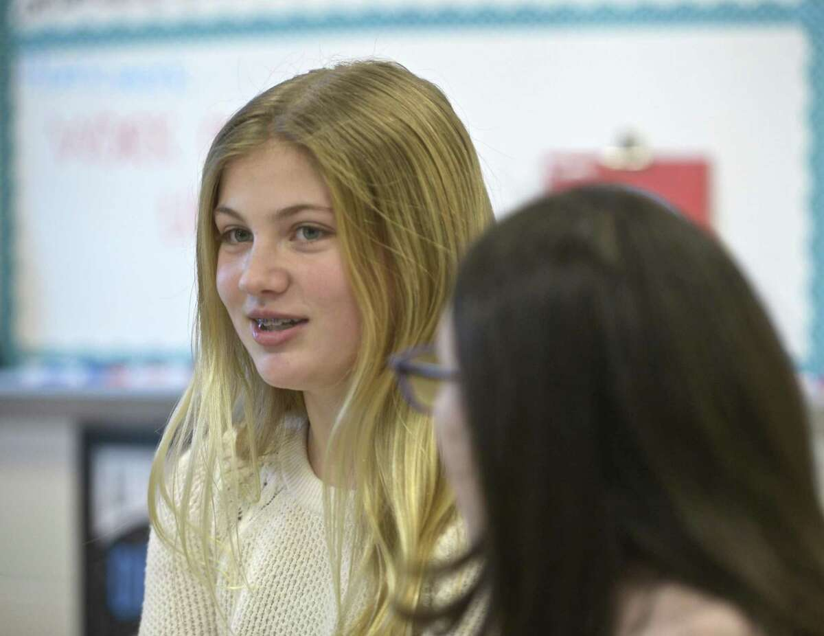 Alexandra Bender, left, and Hannah Stowell, students at Bethel Middle School, started a club at the school to empower girls around the world. The Girl Up club is an offshoot of a United Nations campaign that aims to give young woman the resources to fight for gender equality. Teacher Caitlin Boles is the club advisor. Tuesday, December 18, 2018, in Bethel, Conn.