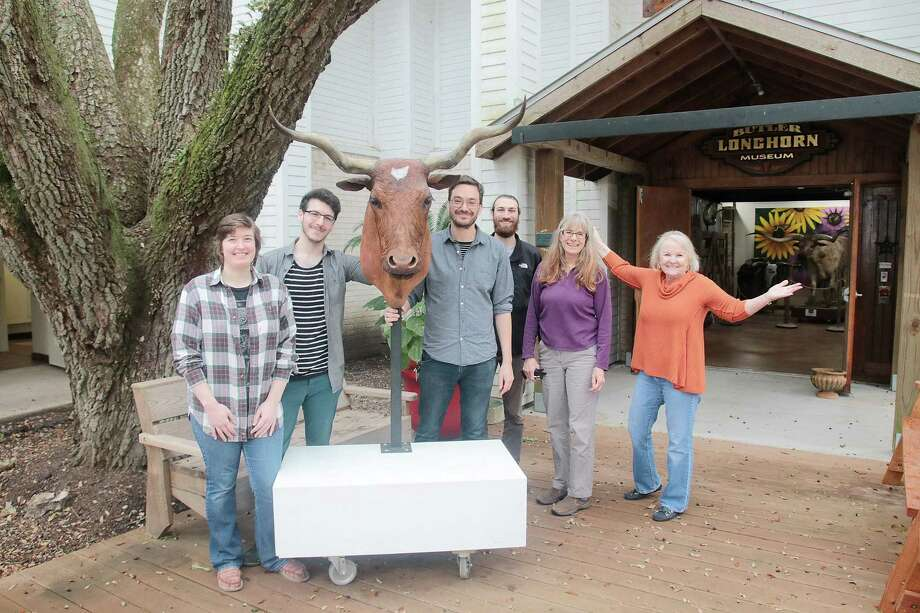 "Moving a longhorn head known as ""Miss Emily"" back into the Butler Longhorn Museum are Emily Thomas, left, James Ponder, Bradly Brown, Michael Leedy, Anita Butler and Monica Hughes. Ravaged by flooding from Hurricane Harvey, the museum is open again, although its education center remains shuttered. Photo: Pin Lim, Freelance / For The Chronicle / Copyright Forest Photography, 2018."
