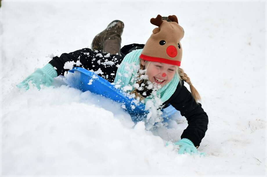 "Reese Ingram, 9, a 3rd grader at Swenke Elem., who was joined by her sister Rylee, 12, a 6th grader at Salyards Middle School and their mom Mandy, works on her snow sledding during the Parkland Village ""Snow Night"" in Bridgeland on Dec. 14, 2018. Photo: Jerry Baker, Houston Chronicle / Contributor / Houston Chronicle"