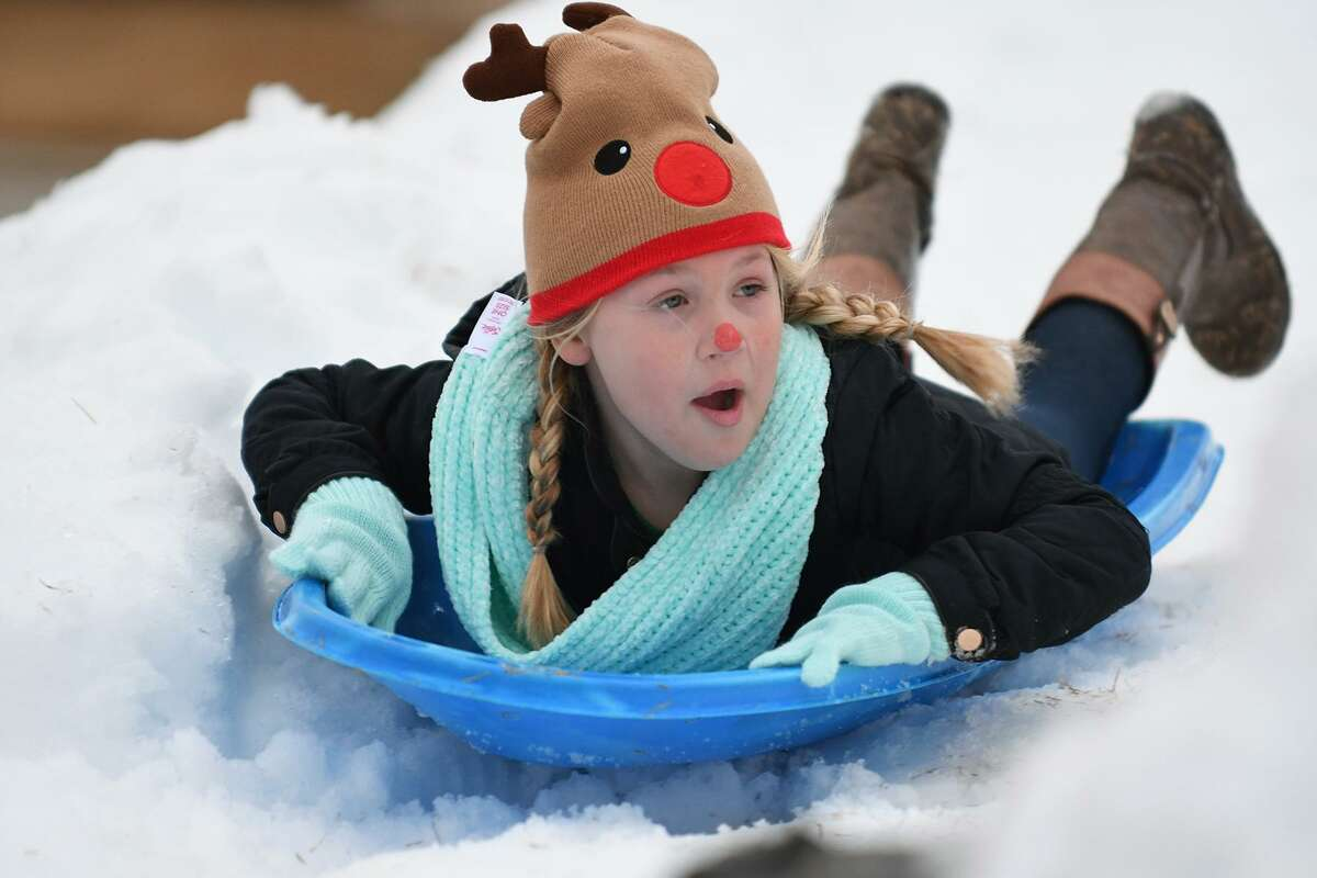 Reese Ingram, 9, a 3rd grader at Swenke Elem., who was joined by her sister Rylee, 12, a 6th grader at Salyards Middle School and their mom Mandy, works on her snow sledding during the Parkland Village