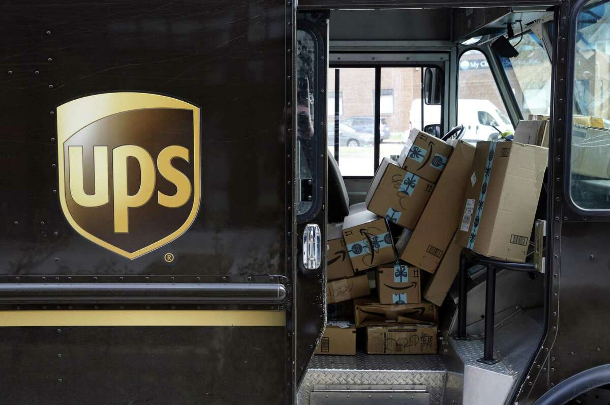 Amazon packages piled up in a UPS truck on Wednesday, Dec. 19, 2018, in Baltimore. (AP Photo/Patrick Semansky)