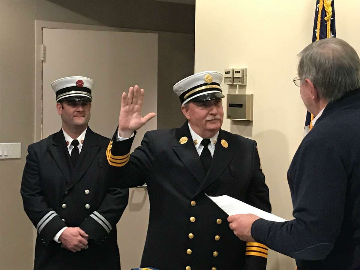"""Chief Fire Marshal Walter """"Bud"""" Seely is sworn in to his new post by Mayor David Martin on Friday, Dec. 21, 2018."""