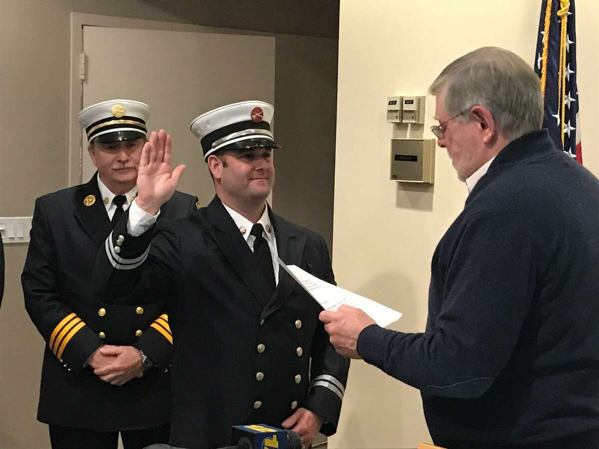 Assistant Fire Marshal Chad Armstrong is sworn in to his new post by Mayor David Martin on Friday Dec. 21, 2018.