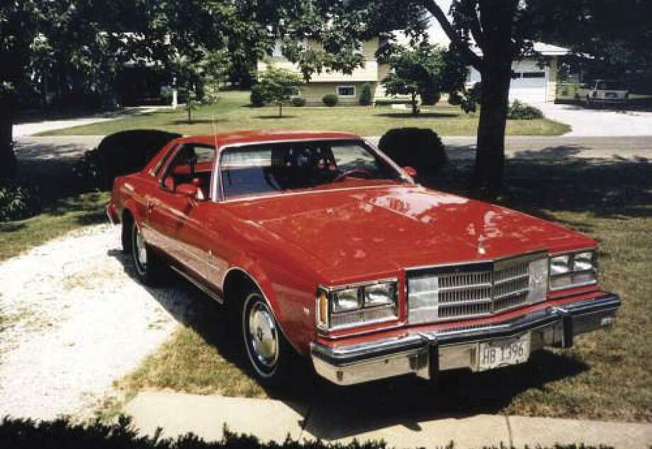 This 1977 Buick Regal coupe car was special-ordered with 40/60 split front seats with a center armrest, vinyl upholstery, AM radio, heater, air conditioner and power disc brakes on the front wheels. The base price of $4,713 was pushed up to $5,453 by the optional extras.