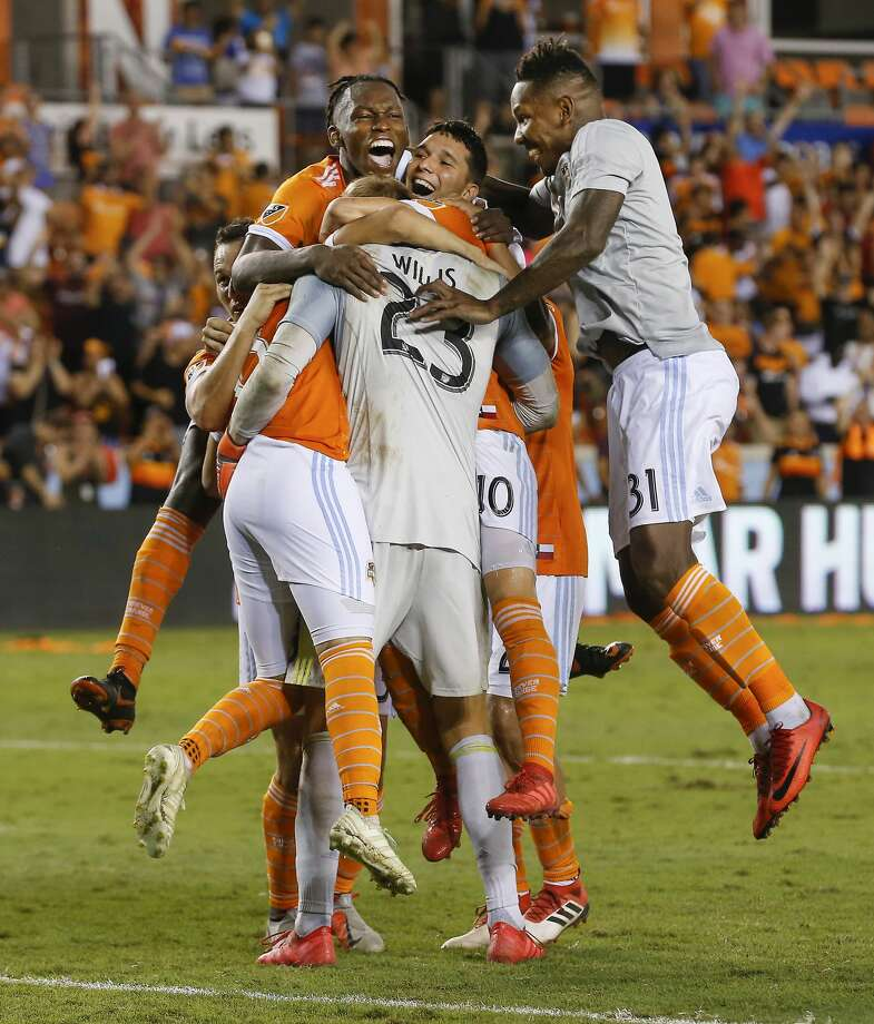 Houston Dynamo goalkeeper Joe Willis (23) is mobbed by his teammates after making the winning save to defeat LA during the 2018 Lamar Hunt U.S. Open Cup Semi-Finals Wednesday, Aug. 8, 2018, in Houston. Photo: Steve Gonzales/Staff Photographer