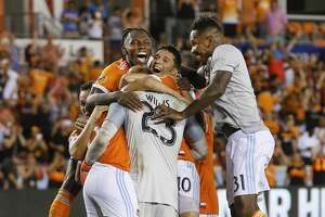 Houston Dynamo goalkeeper Joe Willis (23) is mobbed by his teammates after making the winning save to defeat LA during the 2018 Lamar Hunt U.S. Open Cup Semi-Finals Wednesday, Aug. 8, 2018, in Houston.
